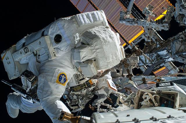 Astronaut carrying out an EVA outside of the International Space Station NASA photo posted on SpaceFlight Insider