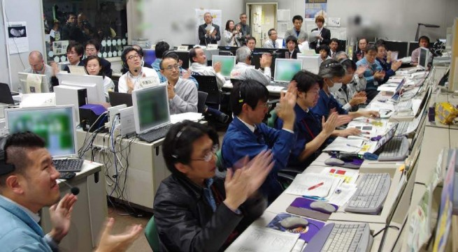 Japanese mission controllers cheer Akatsuki's insertion into Venus orbit.