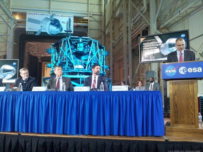 NASA Glenn Director Jim Free speaks as the European Service Module looms behind a panel assembled for a media event inside NASA's Plum Brook Station testing facility. From left to right on the panel are Mike Hawes, Lockheed Martin Orion Program Manager, Mark Kirasich, Orion Program Manager at Johnson Space Center, and Greg Williams, Deputy Associate Administrator for Human Exploration and Operations at NASA Headquarters. Photo Credit: Michael Cole / SpaceFlight Insider