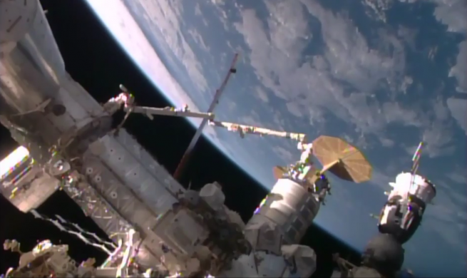 Cygnus being berthed by the space stations robotic arm. Photo Credit: NASA