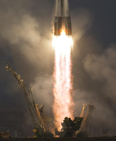 The Soyuz TMA-19M rocket is launched with Expedition 46 Soyuz Commander Yuri Malenchenko of the Russian Federal Space Agency (Roscosmos), Flight Engineer Tim Kopra of NASA, and Flight Engineer Tim Peake of ESA (European Space Agency), Tuesday, Dec. 15, 2015 at the Baikonur Cosmodrome in Kazakhstan. Malenchenko, Kopra, and Peake will spend the next six-months living and working aboard the International Space Station. Photo Credit: (NASA/Joel Kowsky) posted on SpaceFlight Insider