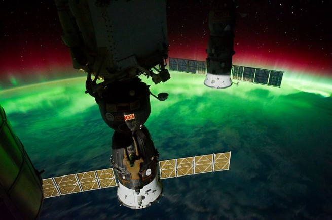 International Space Station Russian Soyuz spacecraft in orbit above Earth NASA photo posted on SpaceFlight Insider