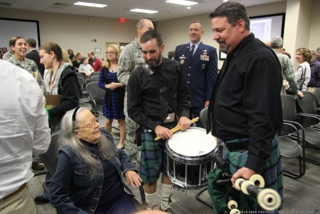 Widow of Apollo 1's Commander Gus Grissom, Betty Grissom compliments the piper and drummer for this evening's ceremony. Photo Credit: Sean Costello / SpaceFlight Insider