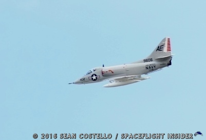 A U.S. Navy A-4E Skyhawk conducts a flyby during Saturday's ceremony. Photo Credit: Sean Costello / SpaceFlight Insider