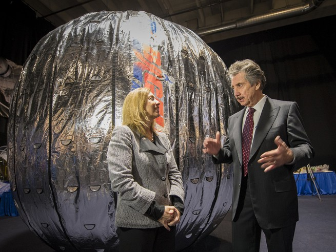 Former NASA Deputy Administrator Lori Garver and President and founder of Bigelow Aerospace Robert T. Bigelow talk while standing next to the Bigelow Expandable Activity Module (BEAM) during a media briefing where is was announced that the BEAM expandable space habitat technology will be tested on the International Space Station, Wednesday, Jan. 16, 2013 in Las Vegas. Photo Credit: Bill Ingalls / NASA