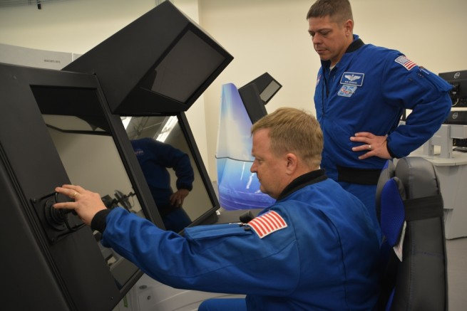NASA astronauts Eric Boe (left) and Bob Behnken inspect the controls of Boeing's CST-100 Starliner Crew Part Task Trainer as part of an early look at one of the systems that will prepare them for flight tests and missions. Photo & Caption Credit: Boeing