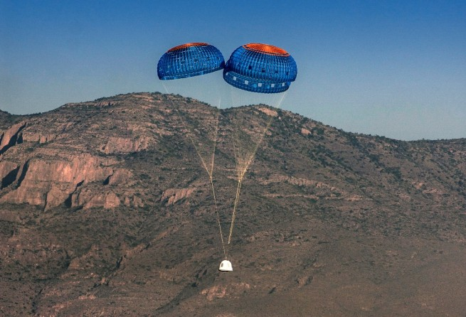 Blue Origin New Shepard capsule descends under parachutes to the ground. Blue Origin photo posted on SpaceFlight Insider