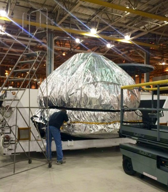 The EFT-1 Orion pressure vessel wrapped-up and ready for shipment to KSC. Photo Credit: NASA
