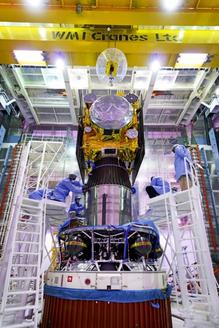 The IRNSS-1E spacecraft being integrated with the PSLV-C31 launch vehicle ISRO image posted on SpaceFlight Insider