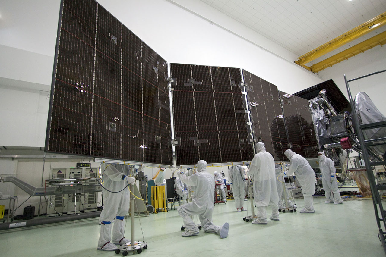 Technicians stow for launch a solar array on NASA's Juno spacecraft. Each of Juno's three solar arrays is 9 feet (2.7 meters wide), by 29 feet (8.9 meters long). Photo Credit: NASA/JPL-Caltech/KSC