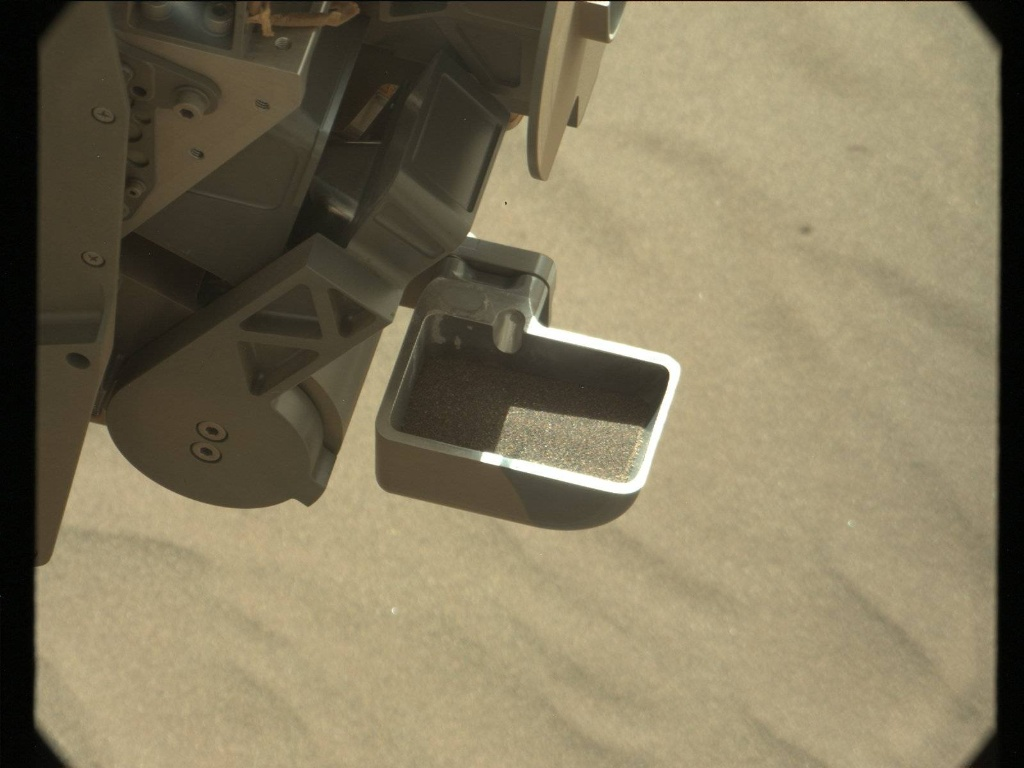 A sample of sand from Namib Dune scoped up by the Curiosity rover. by the Curiosity rover. Photo Credit: NASA/JPL-Caltech