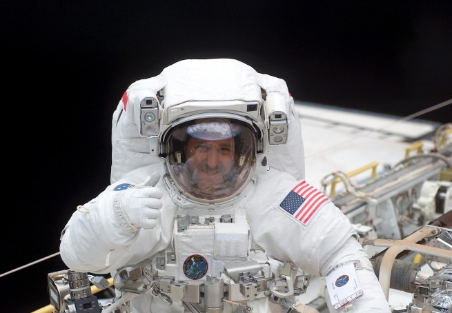 John Grunsfeld during an EVA as seen on Spaceflight Insider