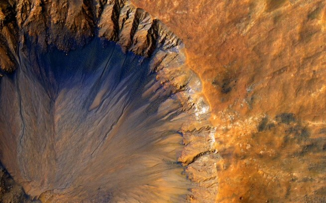 Mars Reconnaissance Orbiter HiRISE image of crater on the surface of Mars. Image Credit NASA posted on SpaceFlight Insider