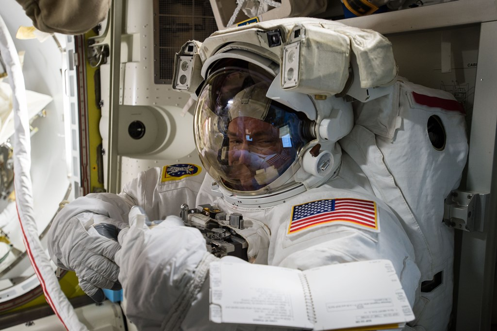 Scott Kelly in spacesuit on the International Space Station NASA photo posted on SpaceFlight Insider