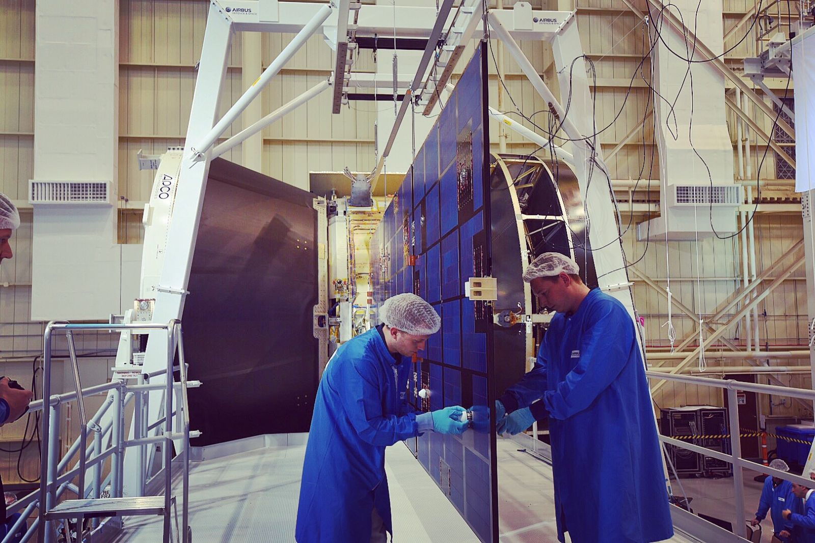 Workers adjust one of Orion's solar array at NASA's Glenn Research Center in Ohio. NASA photo posted on SpaceFlight Insider