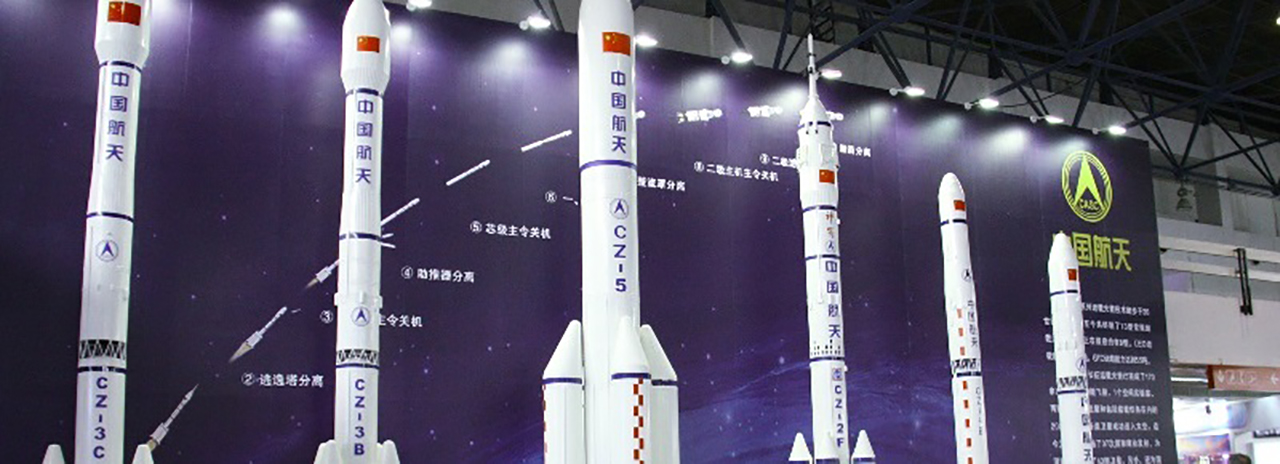 A mockup of the Long March 5 rocket (center) along with models of other launchers of the Long March series.