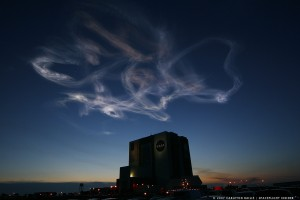 NASA Kennedy Space Center Vehicle Assembly Building STS-117 sky with exhaust plume from Space Shuttle Atlantis.