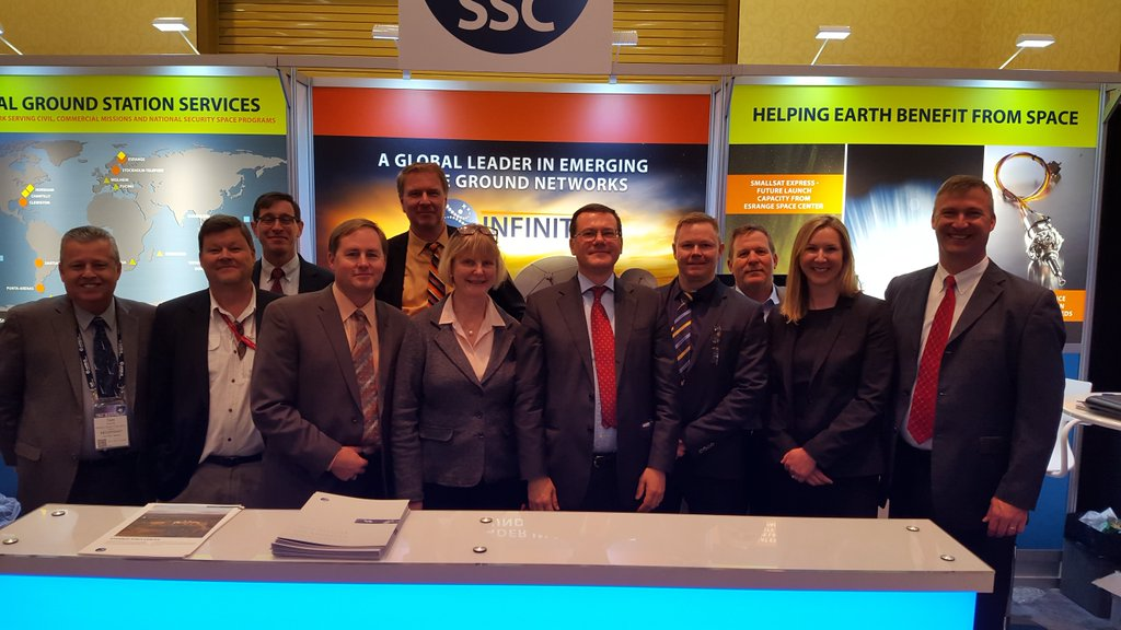 Several members of Team SSC in front of their booth at the Space Symposium.