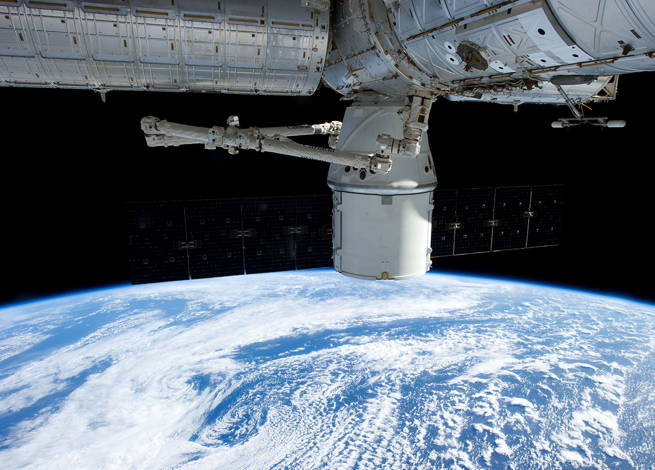 Dragon 'caught' at International Space Station ...