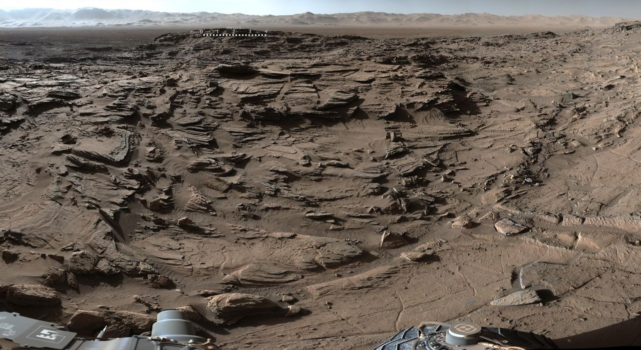 "Curiosity Mars Rover Crosses Rugged Plateau This 360-degree panorama from the Mastcam on NASA's Curiosity Mars rover shows the rugged surface of ""Naukluft Plateau"" plus upper Mount Sharp at right and part of the rim of Gale Crater. Image Credit: NASA/JPL-Caltech/MSSS"