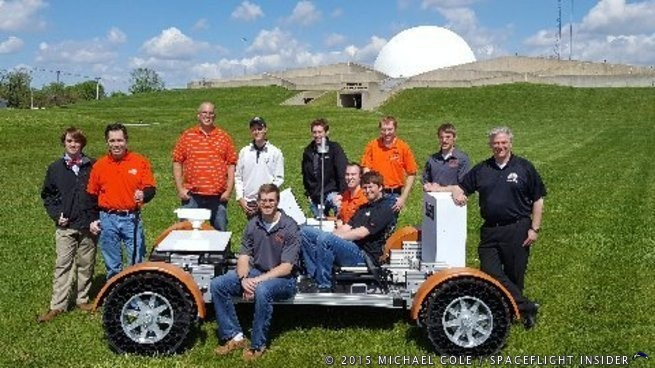 Engineering students and professors from Ohio Northern University in Ada, Ohio, pose on the lawn of the Armstrong Air & Space Museum with the Lunar Rover replica they built for the museum. The students built the rover for the museum as an Engineering Projects In Community Service (EPICS) project. It will be used in parades and other special programs for public outreach until an area for permanent display is built for it at the museum. Photo Credit: Michael Cole / SpaceFlight Insider
