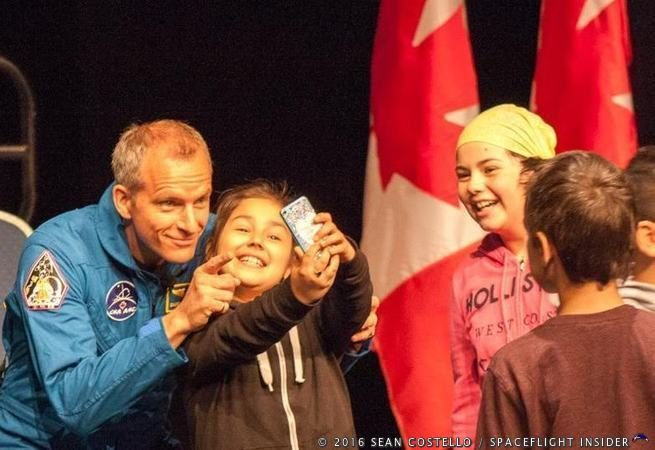 CSA astronaut David Saint-Jacques poses for a fun photograph with one of his many new admirers from Pierre Elliott Trudeau Elementary School in Ottawa, following his assignment to fly to the International Space Station as a part of Expedition 58/59, scheduled to launch in November 2018. Photo Credit: Sean Costello / SpaceFlight Insider