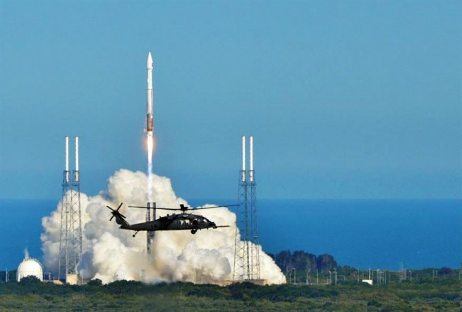 ULA Atlas V 401 rocket launches from Cape Canaveral Air Force Station's Space Launch Complex 41 in Florida with a hh60-G Pavehawk in the foreground. Photo Credit Lt. Colonel Robert Haston USAF posted on SpaceFlight Insider