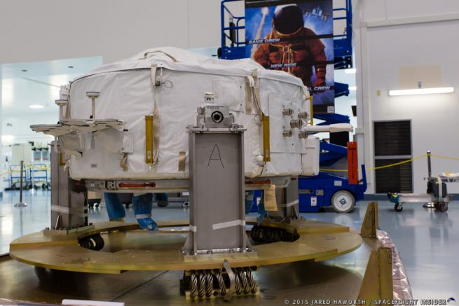 This docking adapter was scheduled for flight on CRS-9 in December -- it's twin was destroyed in the CRS-7 explosion on June 28, 2015. Photo Credit: Jared Haworth / We Report Space