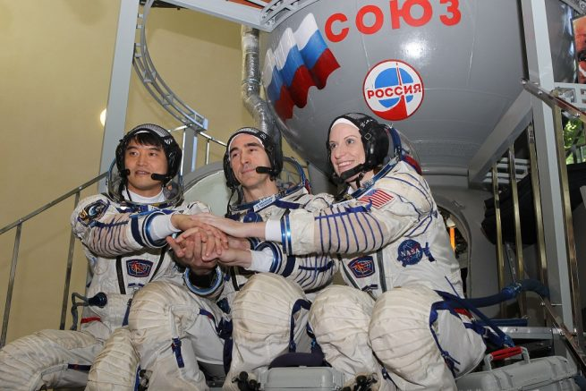 At the Gagarin Cosmonaut Training Center in Star City, Russia, Expedition 48-49 prime crew members Takuya Onishi of the Japan Aerospace Exploration Agency (left), Anatoly Ivanishin of Roscosmos (center) and Kate Rubins of NASA (right) pose for pictures May 27 during their final Soyuz qualification exams.