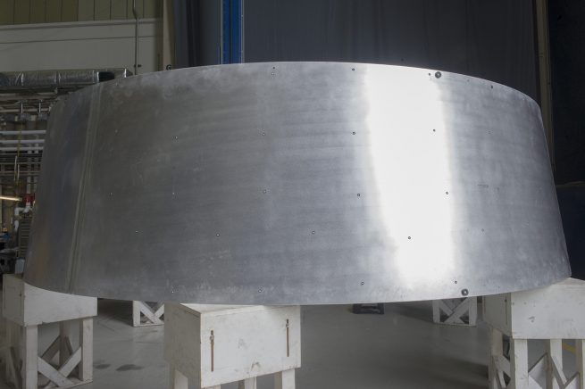 A segment of the Stage Adapter earlier in production at MSFC's Friction Stir Welding facility. (Image: NASA)