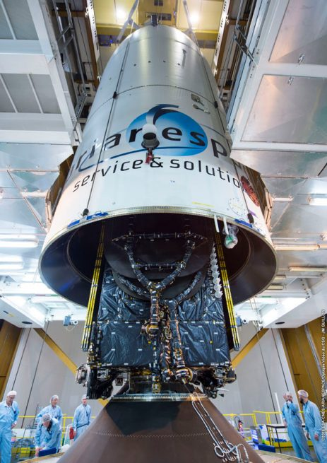 Flight VA230's upper component – composed of EchoStar 18, the SYLDA dispenser system and Ariane 5's protective payload fairing – is lowered over BRIsat to complete launcher build-up for Arianespace's third heavy-lift mission of 2016.