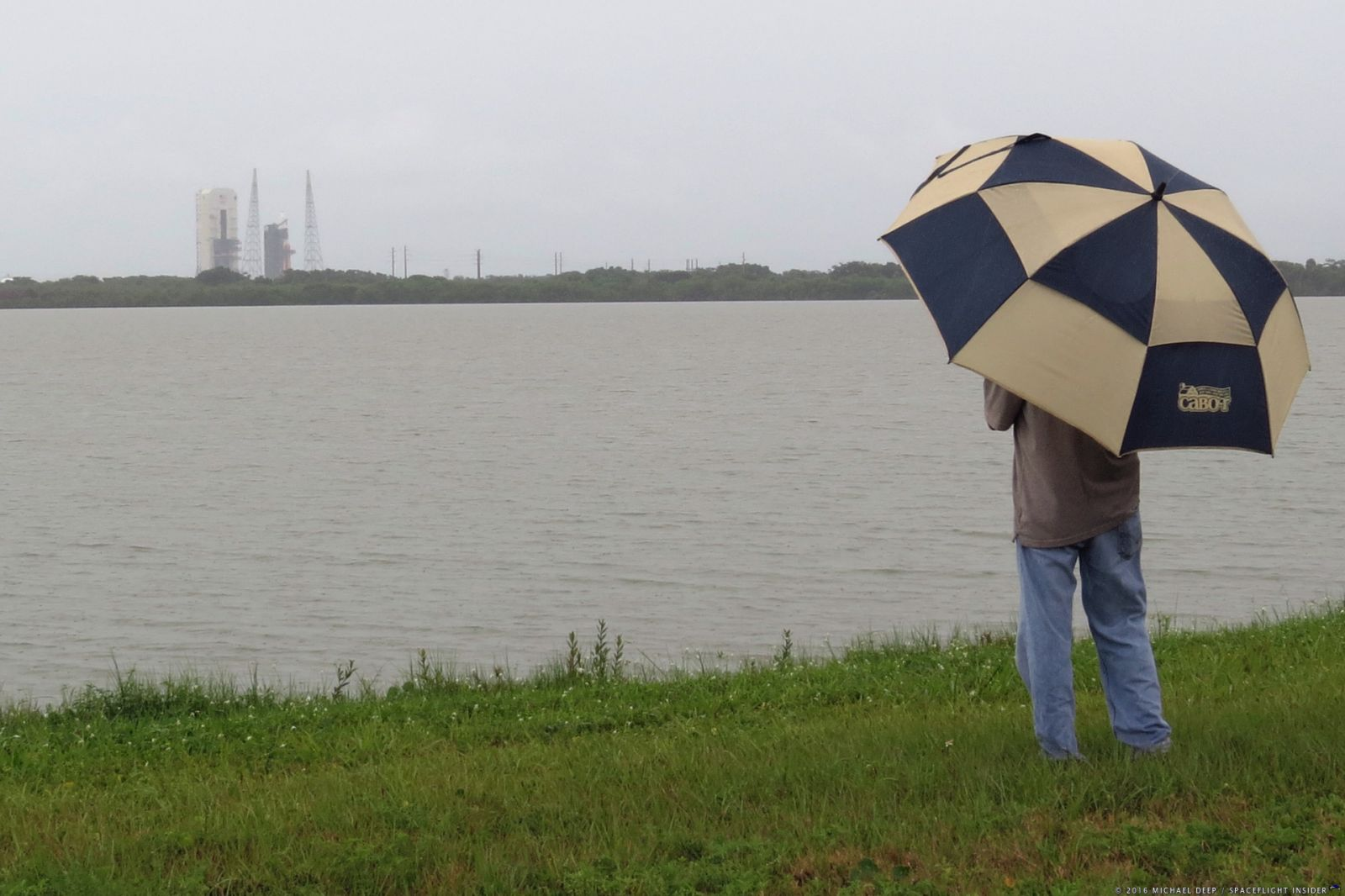 Member of the media looks out at Cape Canaveral Air Force Station's Space Launch Complex 37 at the ULA Delta IV Heavy with NROL-37. Photo Credit: Mike Deep / SpaceFlight Insider