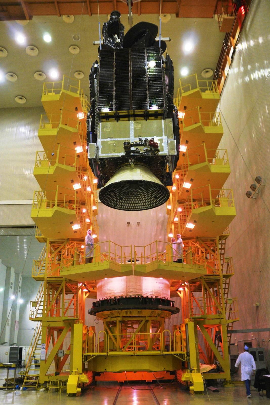 Intelsat 31 and flight adapter being hoisted onto the Briz-M upper stage.