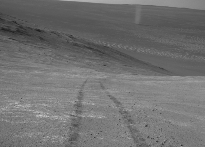 A lone dust devil crosses the frozen plains of Mars in this image captured by NASA's Mars Exploration Rover Opportunity. Image Credit: NASA / JPL / MSSS