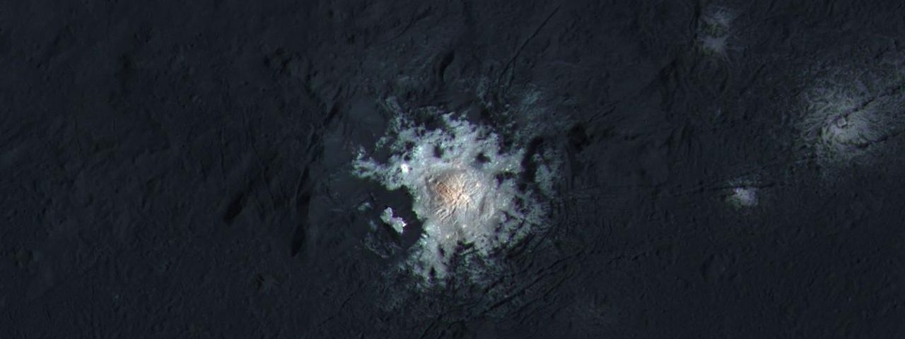 The bright central spots near the center of Occator Crater are shown in enhanced color in this view from NASA's Dawn spacecraft. Such views can be used to highlight subtle color differences on Ceres' surface. Image Credit: NASA/JPL-Caltech/UCLA/MPS/DLR/IDA/PSI/LPI
