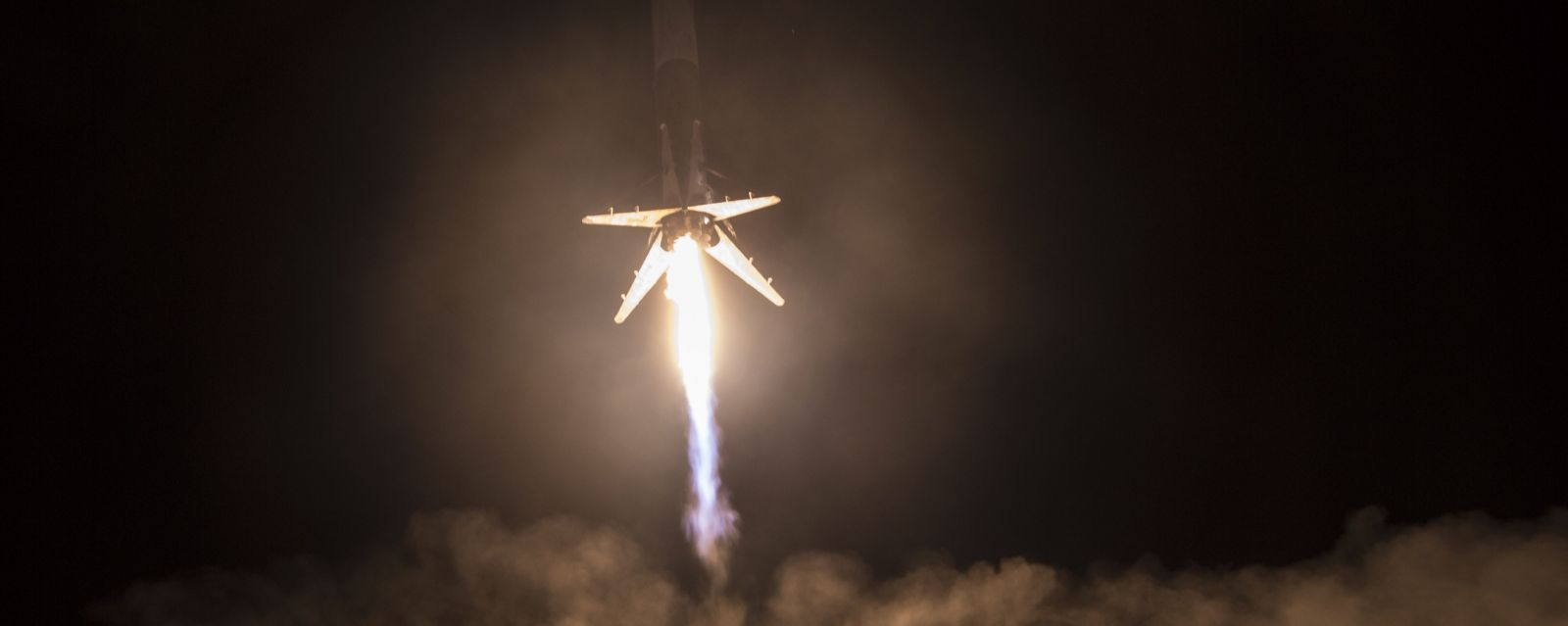 SpaceX's CRS-9 Falcon 9 first stage lands at Cape Canaveral's LZ-1. Photo Credit: SpaceX