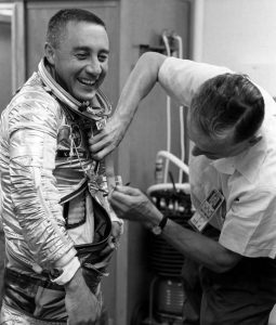 Astronaut Virgil I. Grissom laughs while getting suited up in preparation for his flight on Liberty Bell 7 in 1961. Photo Credit: NASA posted on SpaceFlight insider