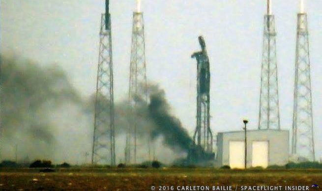 The remains of the Falcon 9 and strong back at SLC-40 continued to smolder for several hours after the Sept. 1, 2016, explosion. Photo Credit: Carleton Bailie / SpaceFlight Insider