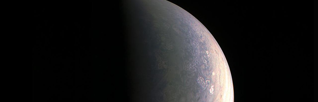 NASA's Juno spacecraft captured this view as it closed in on Jupiter's north pole, about two hours before closest approach on Aug. 27, 2016. Image Credit: NASA/JPL-Caltech/SwRI/MSSS