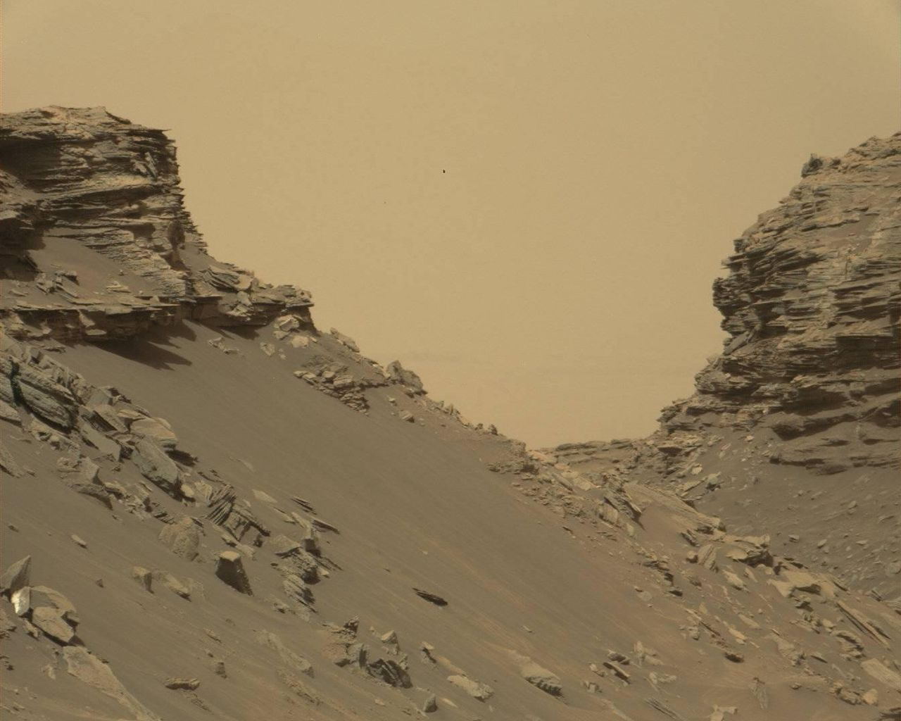 "Curiosity viewed sloping buttes and layered outcrops as it exited the ""Murray Buttes"" region on lower Mount Sharp, Sept. 9, 2016. Image Credit: NASA/JPL-Caltech/MSS"