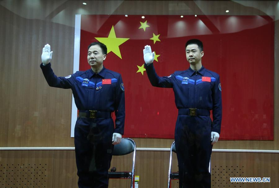 Chinese taikonauts Jing Haipeng (left) and Chen Dong (right) meet the media at a press conference at the Jiuquan Satellite Launch Center in northwest China, Oct. 16, 2016.