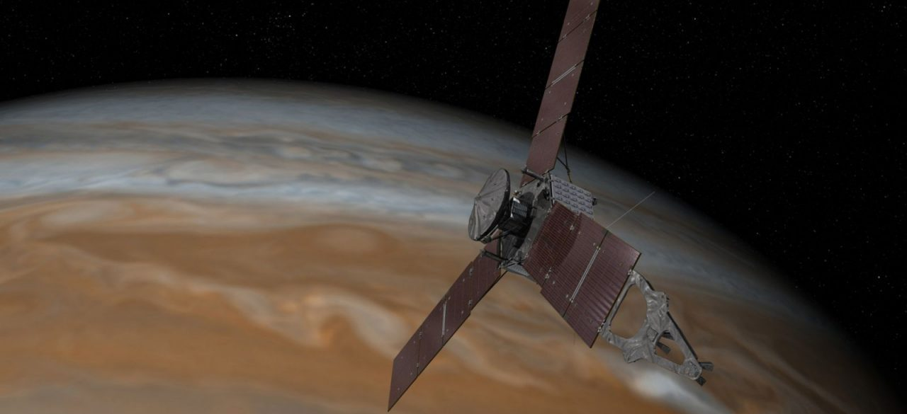 This artist's rendering shows NASA's Juno spacecraft making one of its close passes over Jupiter. The probe is in a highly-elliptical, 53-day orbit around the gas giant. Image Credit: NASA