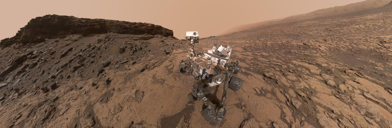 "This September 2016 self-portrait of NASA's Curiosity Mars rover shows the vehicle at the ""Quela"" drilling location in the scenic ""Murray Buttes"" area on lower Mount Sharp. The panorama was stitched together from multiple images taken by the MAHLI camera at the end of the rover's arm. Image Credit: NASA/JPL-Caltech/MSSS"