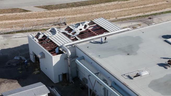 The roof of the VAB's utility annex suffered significant damage, which allowed water to enter the hardware controlling the air chillers. Credit: NASA