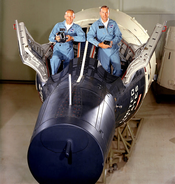 Buzz Aldrin (left) and Jim Lovell pose inside a Gemini spacecraft mockup prior to their flight. Photo Credit: NASA
