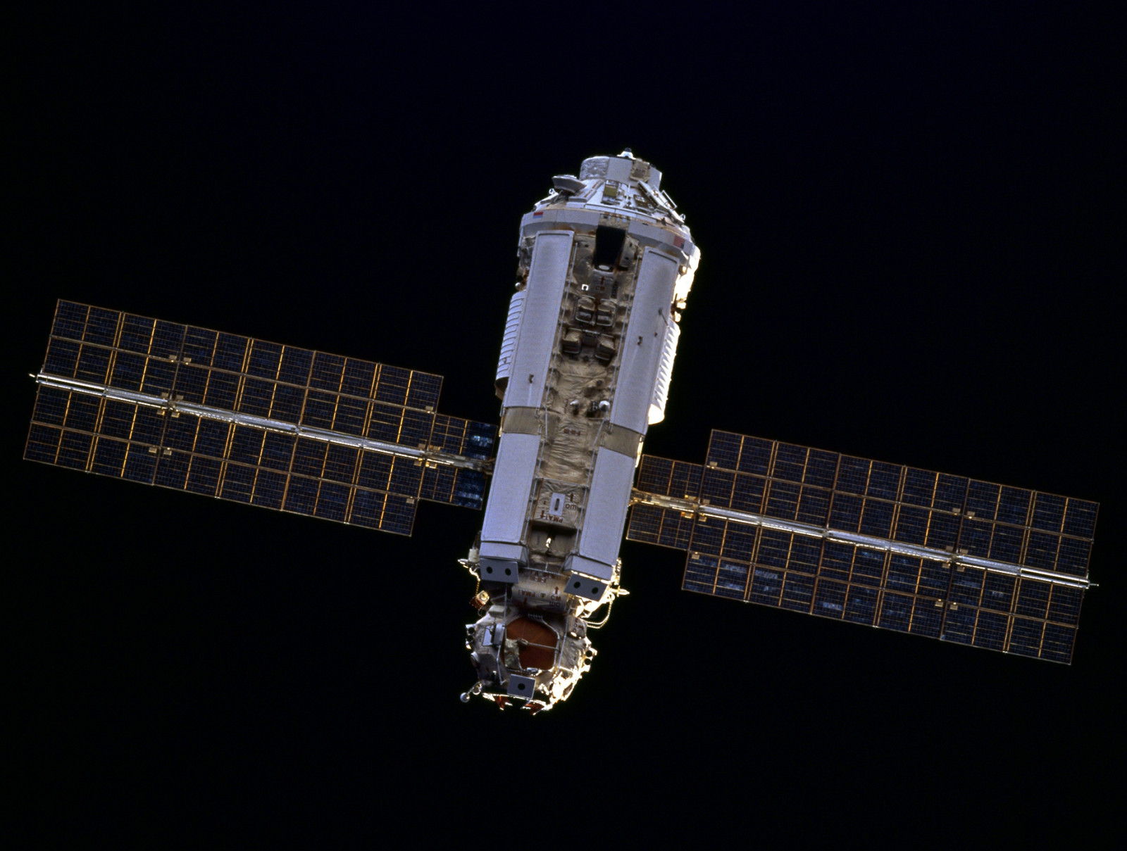 Zarya, the first component of the International Space Station, is seen by the approaching STS-88 space shuttle mission in 1998. Photo Credit: NASA