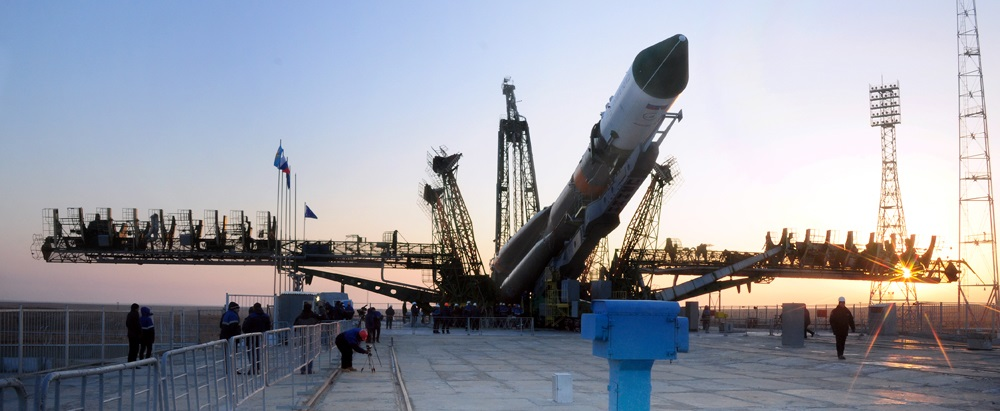 Soyuz-U rocket with the Progress MS-04 spacecraft being erected at the launch pad at the Baikonur Cosmodrome.
