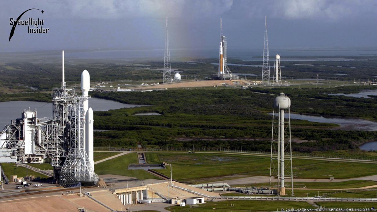 Aerial view of Kennedy Space Center's Launch Complex 39 (A and B). At pad 'A' a SpaceX Falcon Heavy rocket while NASA's Space Launch System super heavy-lift rocket sits at Pad 'B'.
