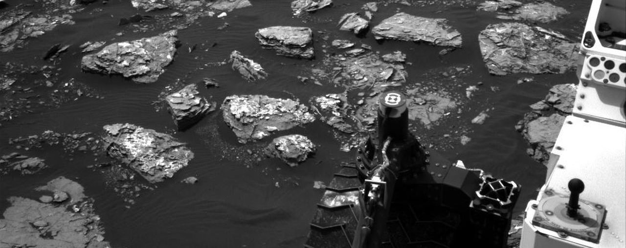 "This Dec. 2, 2016, view from the Navigation Camera (Navcam) on the mast of NASA's Curiosity Mars Rover shows rocky ground within view while the rover was working at an intended drilling site called ""Precipice"" on lower Mount Sharp. Image Credit: NASA/JPL-Caltech"