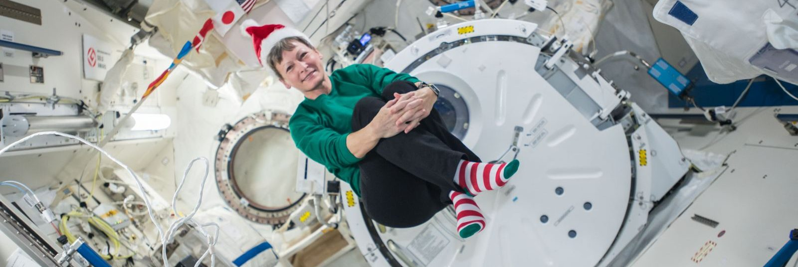 Expedition 50 astronaut Peggy Whitson sent a festive photo to those on the ground. She and Tomas Pasquet will perform two critical maintenance spacewalks in the first two weeks of 2017. Photo Credit: NASA